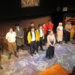 Photograph of the cast of Candleford singing Jacob's Well at Sewell Barn Theatre in Norwich