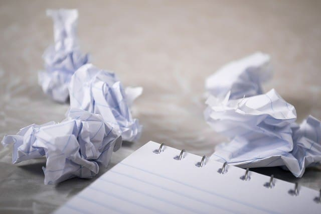 writer's block and screwed up balls of paper