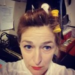 Marie Cooper actor with curlers in, getting hair ready for stage