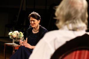 Photo of Marie Cooper actor as Anna Mary, moaning at Verner during the stage play Come into the Garden, Maud