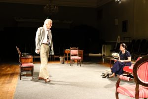 Photo of Verner Conklin and Marie Cooper actor as Anna Mary arguing after the dinner party onstage during Come into the Garden, Maud